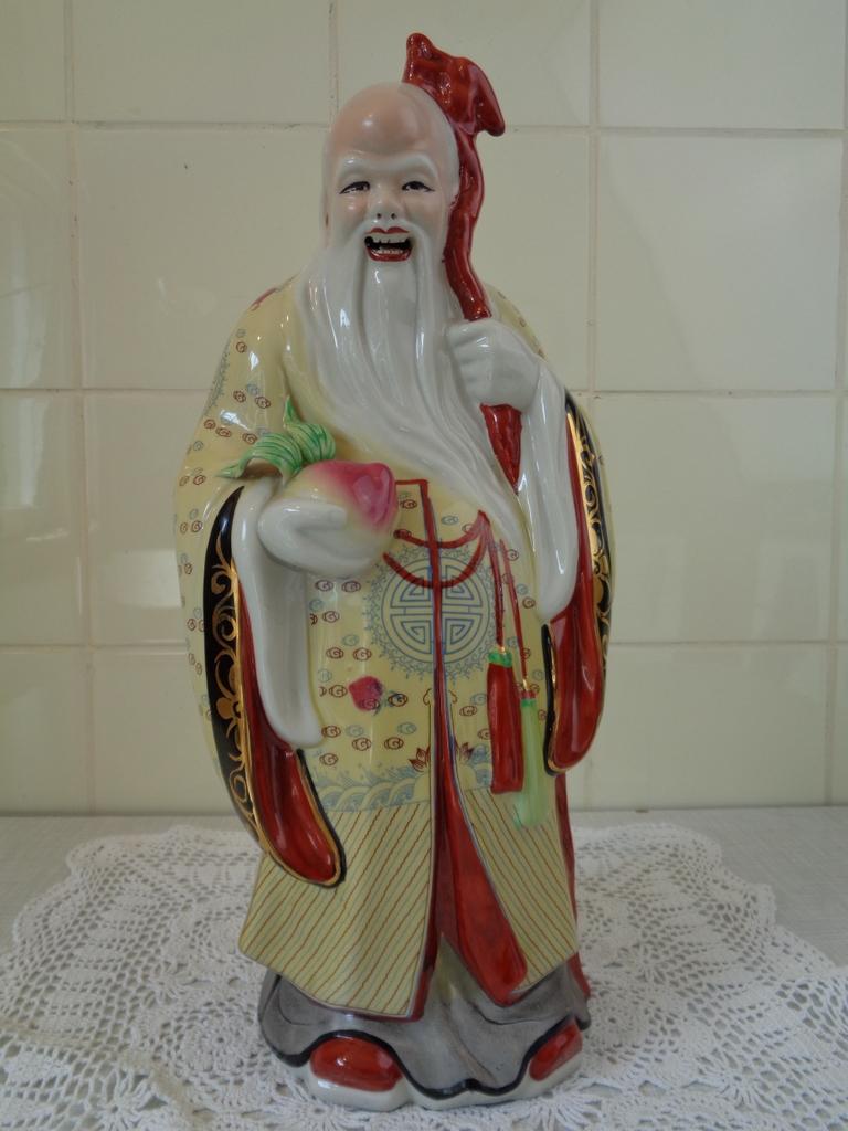 Porseleinen beeld Chinese oude man