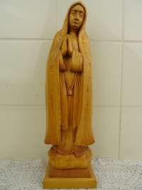 Antiek houten Mariabeeld met serene expressie