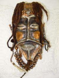 Afrikaans koperen masker